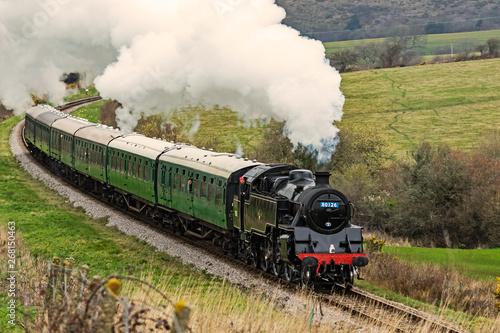 Fotografía Steam locomotive working hard pulling a train