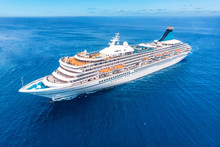 Cruise Liner Ship In Ocean With Blue Sky. Aerial Top View