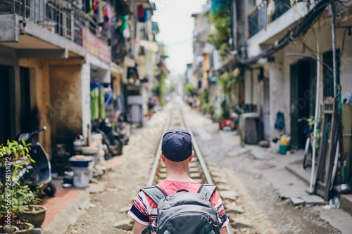 Traveler in Hanoi Train Street
