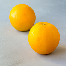 Gray Background Two Oranges