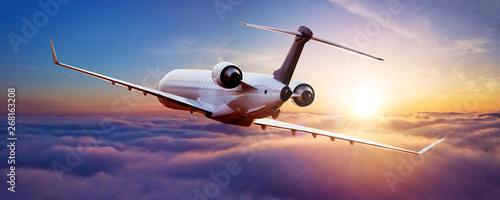 Obraz Private jet plane flying in sunset - fototapety do salonu