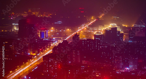 Foto auf AluDibond Kastanienbraun Beijing. Cityscape image of Beijing downtown during twilight blue hour.