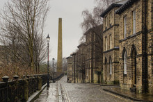 Albert Terrace, Saltaire, Yorkshire Is An Iconic Victorian Street Scene With Its Cobbled Street, Workers' Houses And Mill Chimney, A Resource Often Used By Film Makers Seeking Authentic Scenery