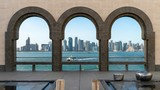 Doha skyline through the arches of the Museum of Islamic art, Doha, Qatar
