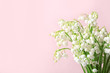 Leinwandbild Motiv Beautiful lily of the valley flowers on color background, space for text