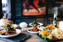 Assorted Thai Food On Wooden Table