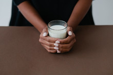 Glass With Milk In Woman`s Hands