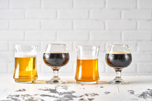 Sample Flight Of Beers Including A Lager, Stout, Porter, And IPA