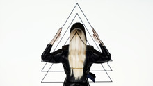 Woman Against Slide With Triangles