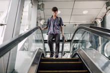 Young Skater Using Escalator Stairs Downtown