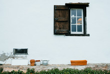 White Facade With A Window Of A Rural House