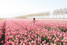 Happy Young Woman In A Tulip F...