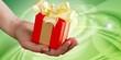 Leinwandbild Motiv Human hand holding Little christmas box with bow isolated on white background