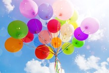 Bunch Of Colorful Balloons On Sky Background