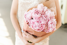 Woman Holding Bouquet Of Pink Peonies