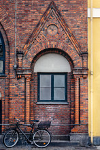 Brick Wall With Window And Bicycle In Copenhagen