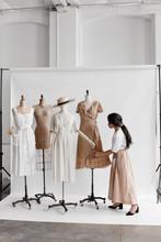Shop Owner Dressing Mannequins...
