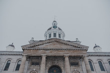 Close Up Front View Of City Hall In Kingston, Ontario On A Snowy Day.