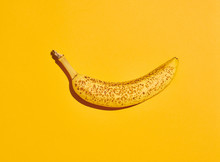 Overripe Banana On Yellow
