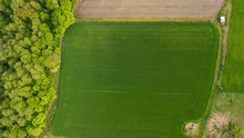 River And Fields Top View. Photographed From The Drone. Beautiful View Of The Agropolis. Spring. Green Fields