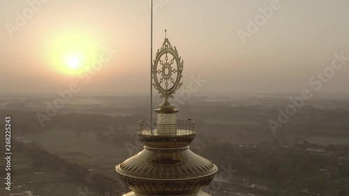 Fotografie, Obraz Chakra on temple top, India 4k aerial drone ungraded/flat