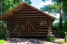 Old Authentic Traditional Wooden Long Barn In The Woods To Store A Long Antique Fishing Boat On The Island Of Seurasaari In Helsinki In Finland On A Summer Sunny Day.