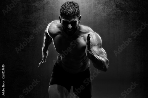 Fotografia, Obraz  Muscular Men in Running Motion. Handsome Male Athlete Sprinting