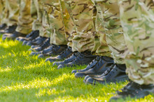 Soldiers On Parade On A Grassy Field.