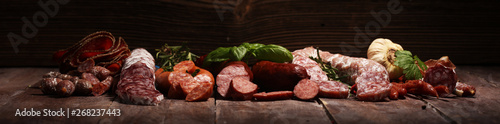 cold meat assortment with delicious salami and  fresh herbs Fototapeta