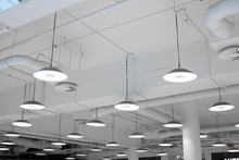 Shopping Center Led Lighting. Ceiling Lights In The Mall. Ventilation And Water Pipes. Fire Alarm System