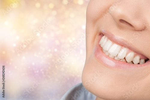 Photo sur Aluminium Manicure Beautiful wide smile of young fresh woman with great healthy white teeth. Isolated over white background