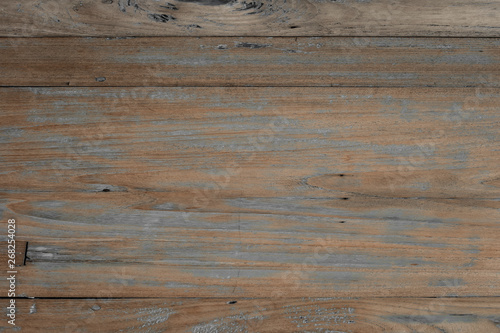 Close-up of wall made of wooden planks. Old dark brown wooden wall background texture.