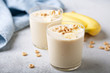 Healthy banana smoothie in glasses topped with cereal