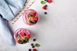 Leinwandbild Motiv Fresh mixed berry smoothie topped with granola overhead