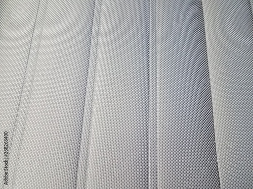 grey upholstery on seat or chair or background