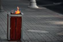 Burning Trash Can. Burning Gar...