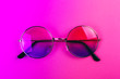 canvas print picture - Round summer sunglasses on neon duotone light. Trendy background.