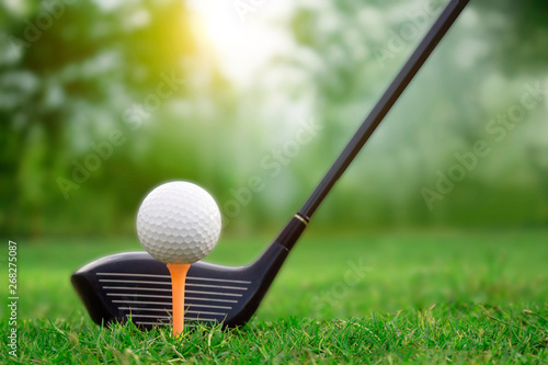 In de dag Golf Golf clubs and golf balls on a green lawn in a beautiful golf course