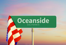 Oceanside – California. Road Or Town Sign. Flag Of The United States. Sunset Oder Sunrise Sky