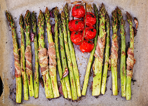 Grilled green asparagus wrapped with bacon. Top view