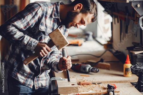 Slika na platnu A man carves a tree