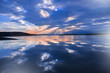 Incredibly beautiful sunset.Sun,sky,lake.Sunset or sunrise landscape, panorama of beautiful nature. Sky with amazing colorful clouds.Water reflections.Magic Artistic Wallpaper.Blue Background.Light.