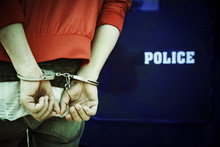 A Man Being Arrested And Handc...