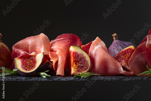 Photo  Figs with prosciutto and rosemary.