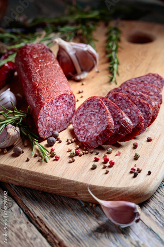 Fotografie, Obraz  Salami with rosemary, garlic, pepper and spices.