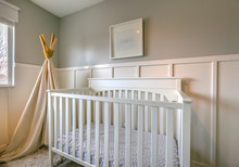 Interior Of A Room For Children With White Wooden Crib And Play Teepee