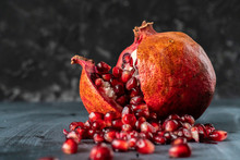 A Large Opened  Pomegranate Fruit With Many Seeds Grains Fall Pouring Out Of It S