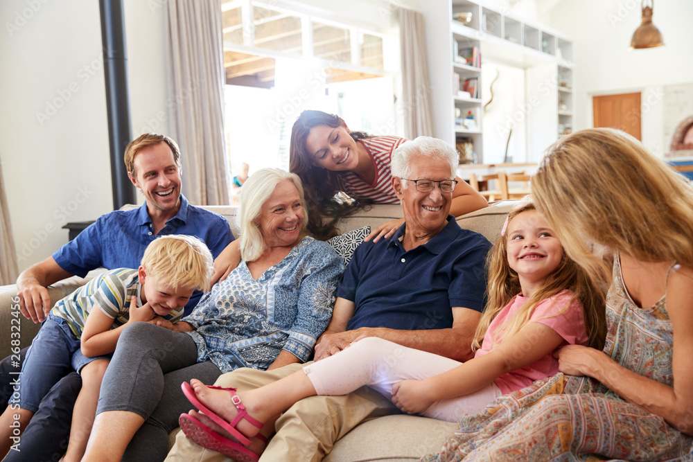 Fototapety, obrazy: Multi-Generation Family Sitting On Sofa At Home Relaxing And Chatting