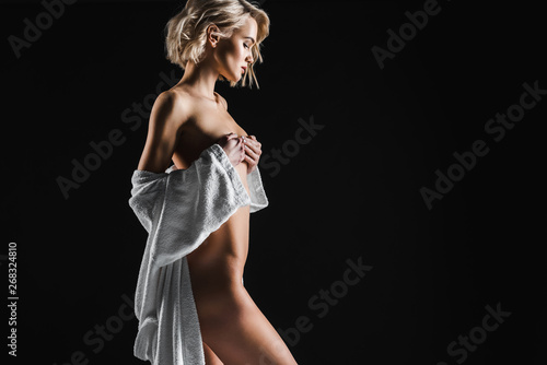 Obraz beautiful sexy half-naked young woman in white bathrobe posing isolated on black with copy space - fototapety do salonu