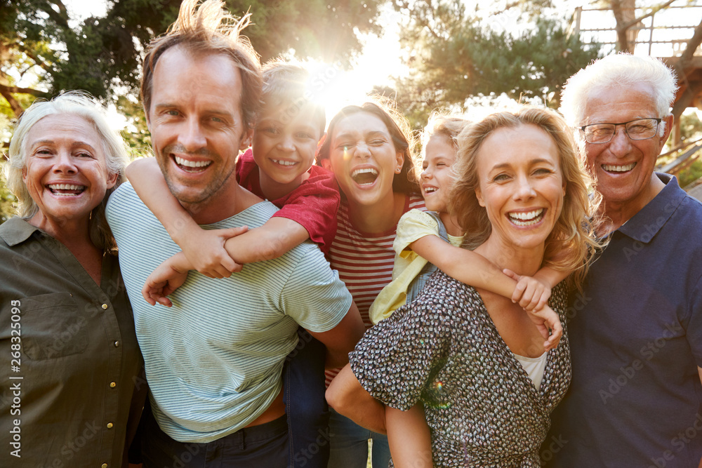 Fototapeta Outdoor Portrait Of Multi-Generation Family Walking In Countryside Against Flaring Sun